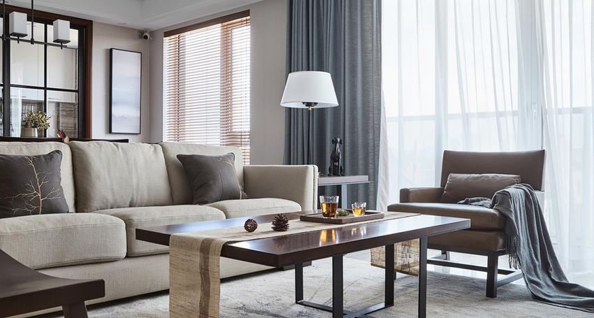 一抹蓝灰色的亚麻感的窗帘,带有一丝灵动,也丰富了空间层次。
