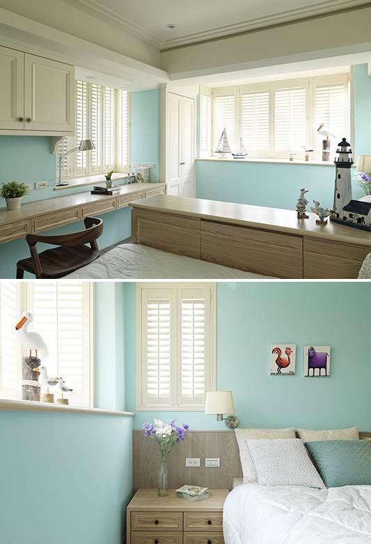 设计师在水蓝色男孩房中,利用矮柜区隔出床铺增加隐秘性。