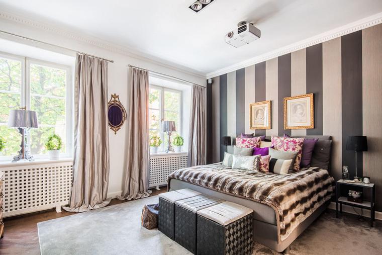 深色调的卧室空间显得华贵得多。