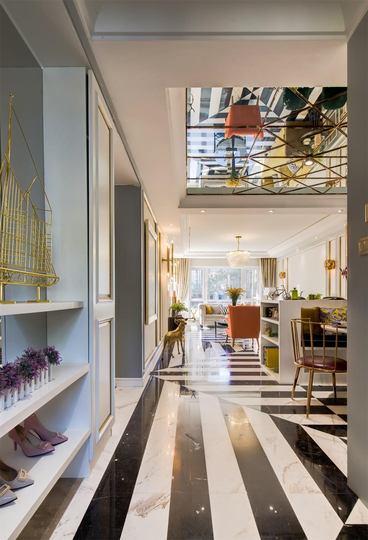 玄关设计巧妙衔接了餐厅与客厅,视觉延伸感强烈,空间层次得到妥善安置。