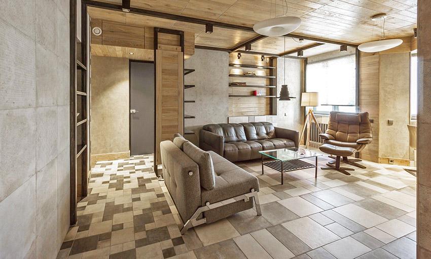 搭配棕色皮革沙发、单人座椅,展现屋主大器不凡个人风格,公共区域以天然元素塑造水泥和木系的中性美学。