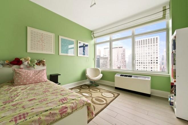 卧室延续客厅整体色调,清新舒适