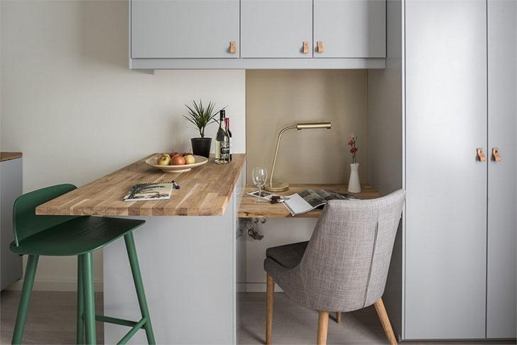 这间公寓呈长方形,室内包括了厨区、餐区、卧室以及浴室。