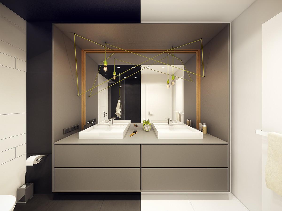 卫生间的墙面以黑白灰为主,搭配绿色的小吊灯格外别致,简约而精致。
