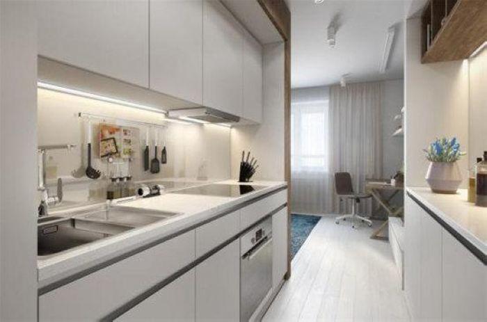 厨房对面是收纳的橱柜搭配,一条过道左右各有功能,浓缩功能空间在小户型里。