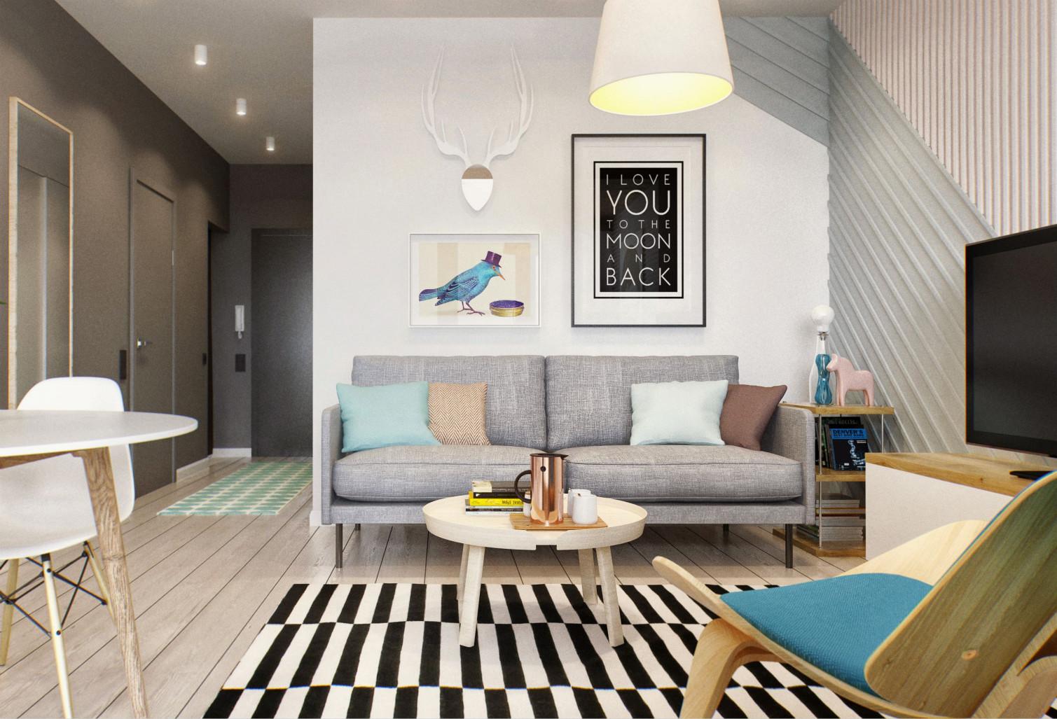 客厅简约时尚,浅色布艺沙发以及沙发背景墙上挂画,艺术气息充满整个客厅