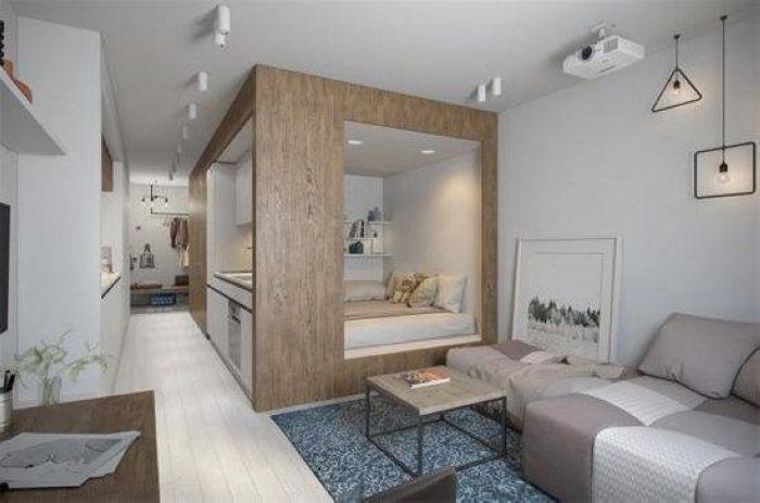 卧室的设计秉承了一个屋中屋的概念,抬高设计添置了收纳空间,规整的长方体设计,让小屋看起来更为整洁。