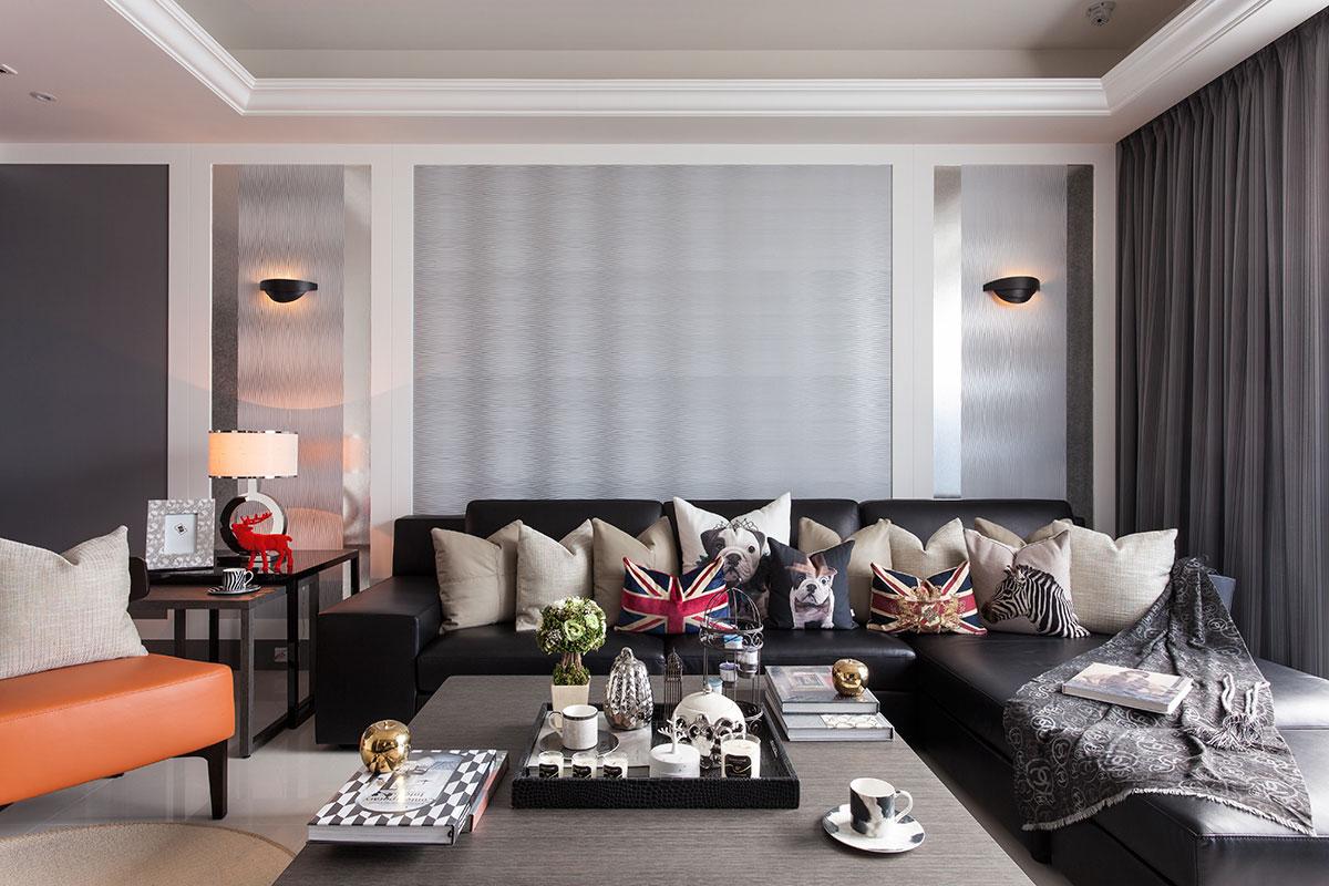 黄色皮质单人沙发,红色装饰品,为灰色的空间增添了活泼感。