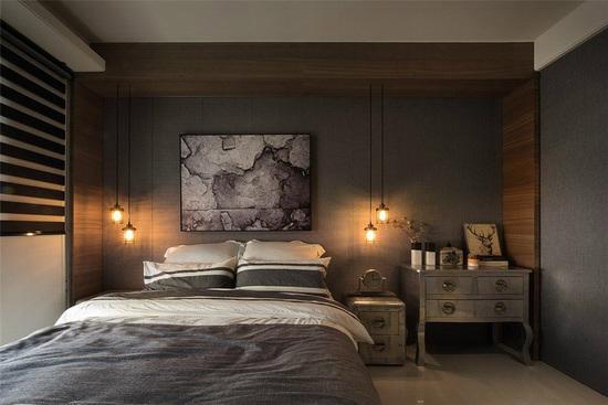 简练的灰色调搭配木质元素,为卧室空间添色加温,形塑温暖舒适的情境。