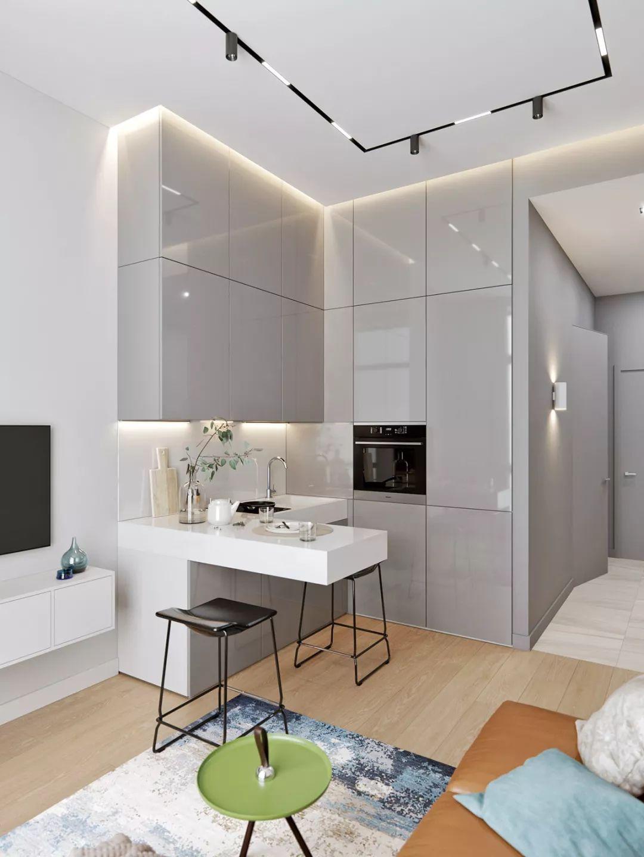 这间小户型住宅将客厅、厨房、餐厅全都整合在一处,利用最小面积打造最实用的生活空间。
