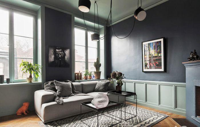 客厅地面的人字形木地板给空间带来视觉灵动感,同时增加了空间的环保清新气息。
