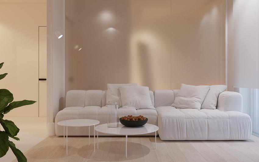 在客厅,大型豪华沙发和配套的咖啡桌位于中心。