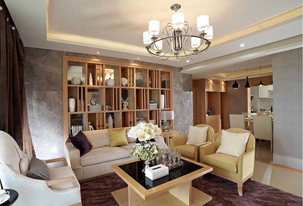 客厅背景墙做的格子柜,做了很好的收纳,精致的物品摆放是整个空间典雅