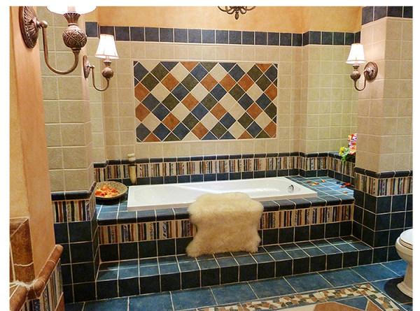 多彩的瓷砖拼接设计让卫生间整体的空间都生动起来,色彩营造情调,创造美妙的效果。