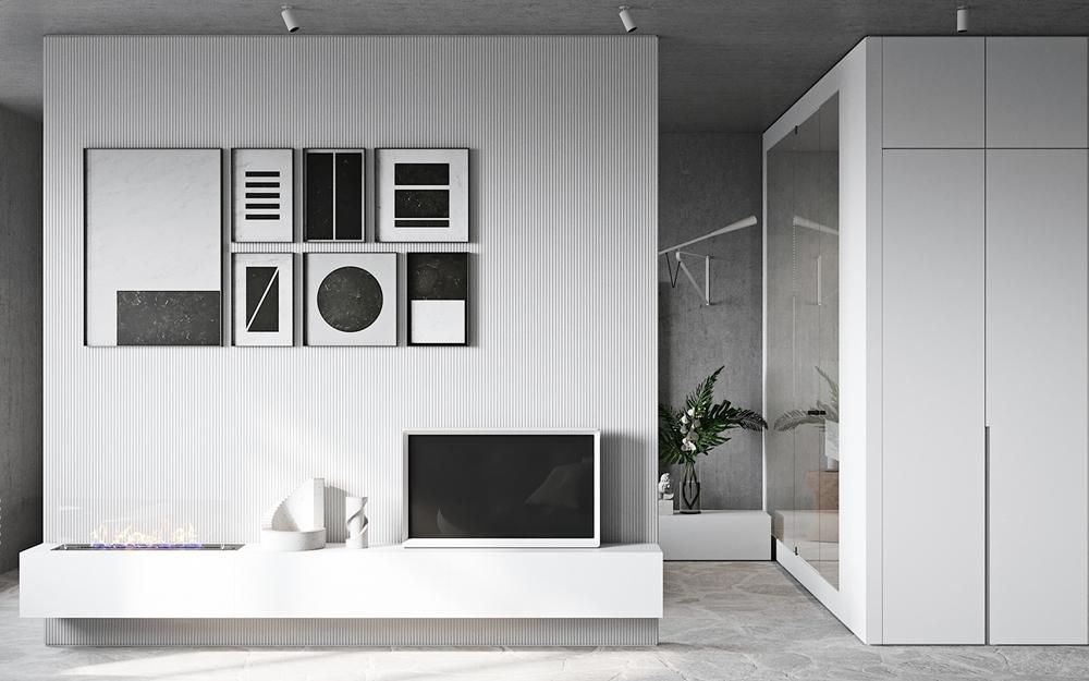 白色背景墙和黑色装饰画形成色感对比,打造出一个时尚简约的空间。
