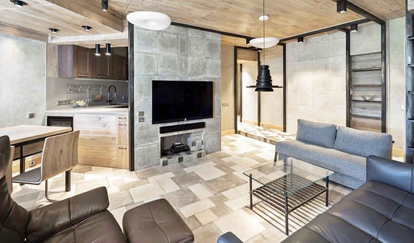 运用木质天花板、混凝土墙面塑造居家原始调性,轨道灯、造型灯饰让空间多了几分设计感。