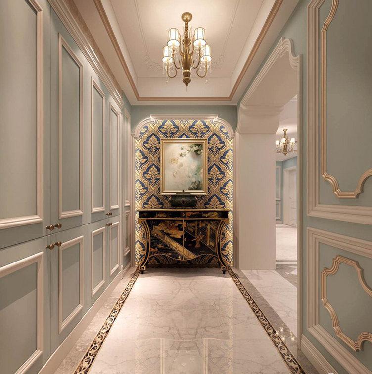 玄关被巧妙地开拓出了墙面式收纳柜,浅蓝色搭配白色让几何立体成就空间的一份清雅,同时,呼应蓝白石膏墙。