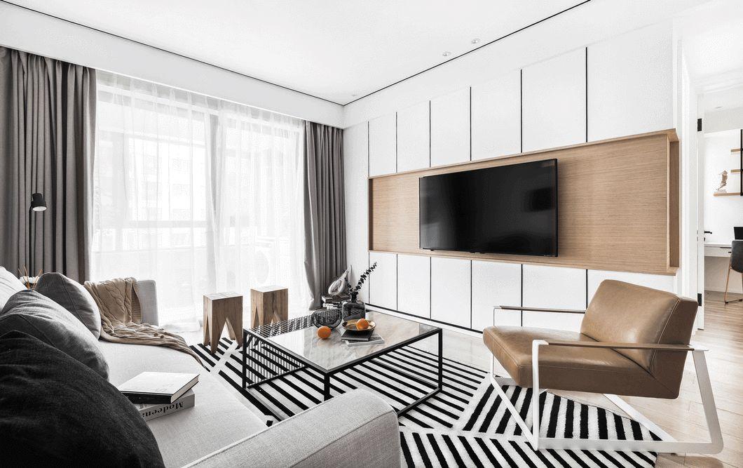 在电视背景的设计上摒弃虚华与厚重的材质,用简单的石膏板刷白代替传统的白色墙板,搭配木饰面和黑色不锈钢