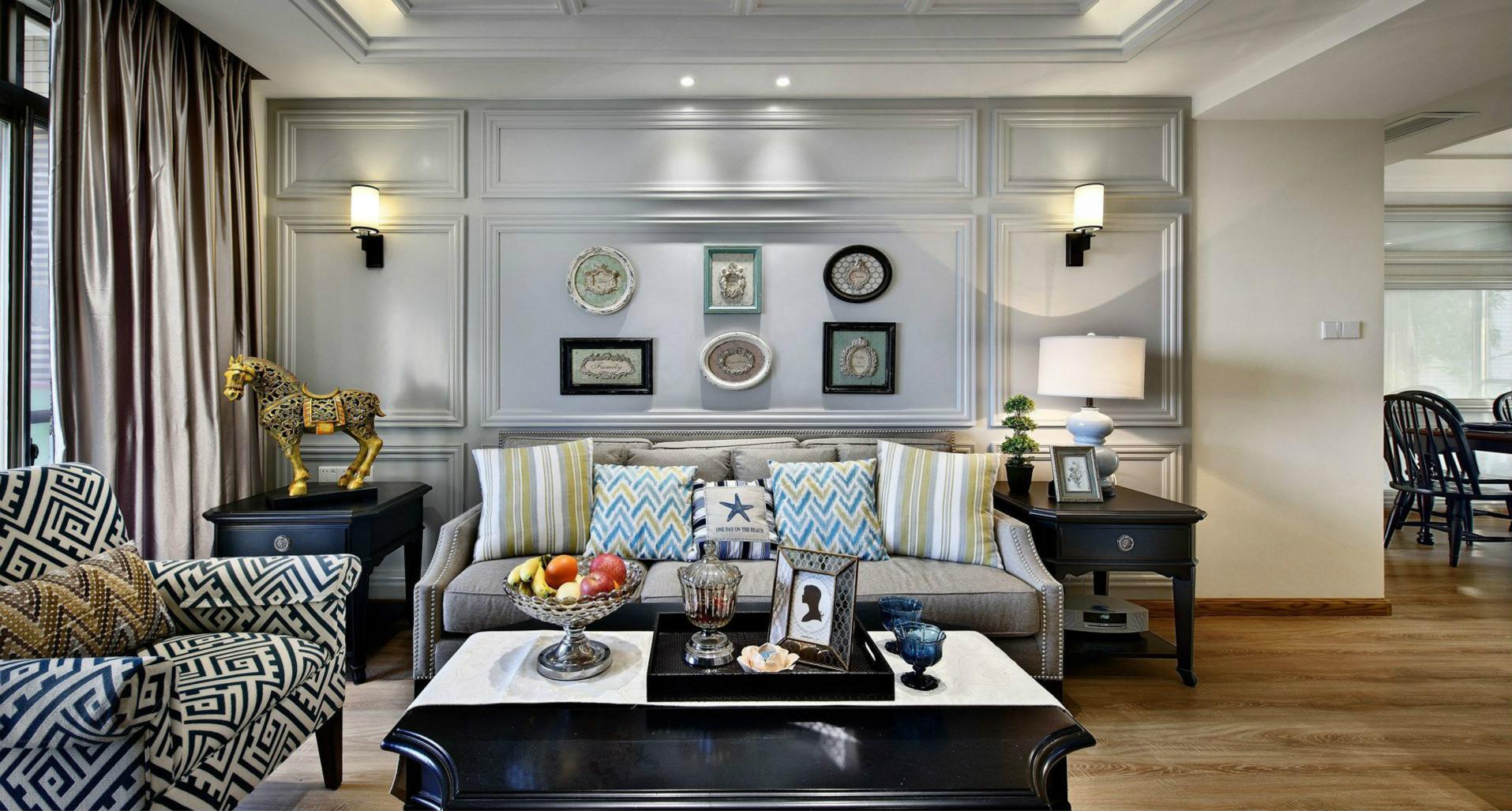 背景墙贯穿整个空间,显得气质非凡。绿植的摆放不仅增添了生机,还与沙发墙上的挂画相呼应。