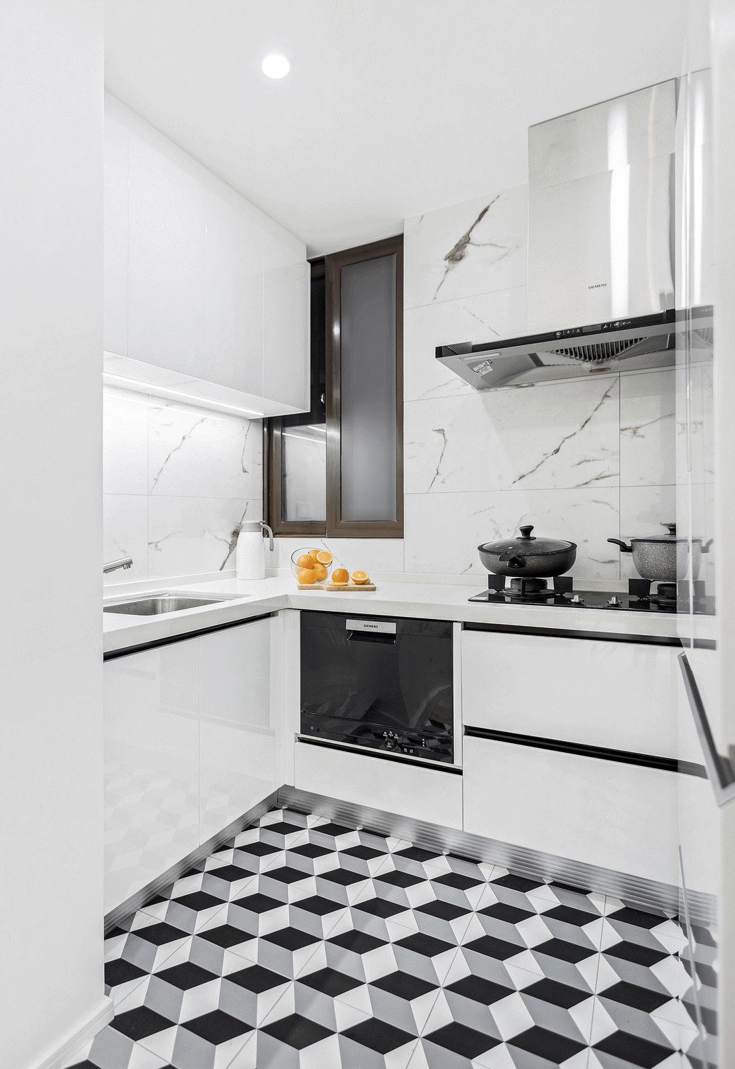 厨房同样以白色为主色调,黑色线条做点缀,配上地面的几何花纹,时尚且酷。