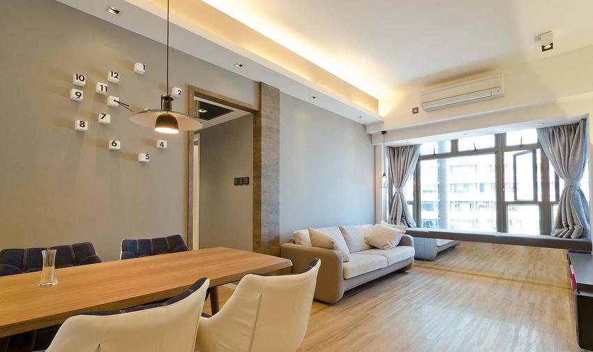 大面积的灰色墙面加上布艺沙发和原木家具,整个客厅简洁利落。