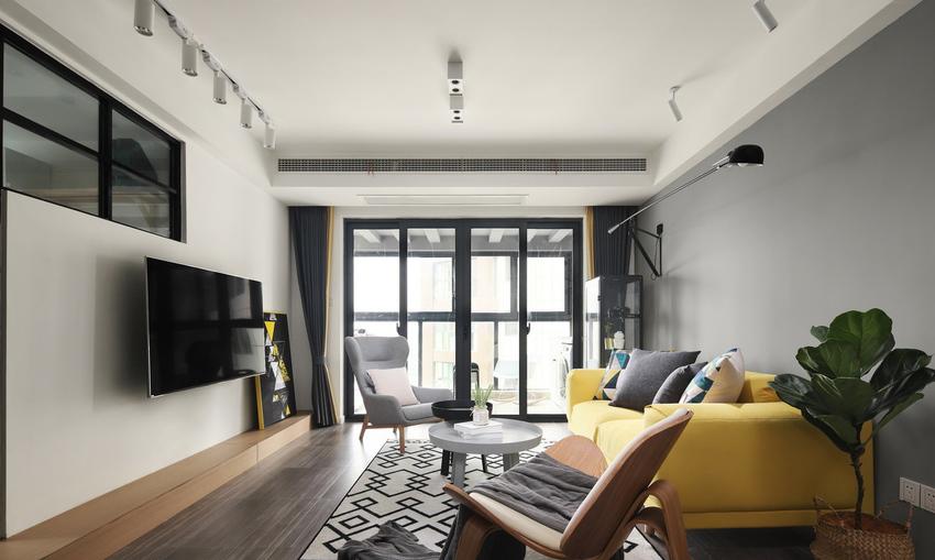 冷灰色的墙面与暖黄色的沙发,形成了很好的视觉碰撞,让这个空间有亮点。