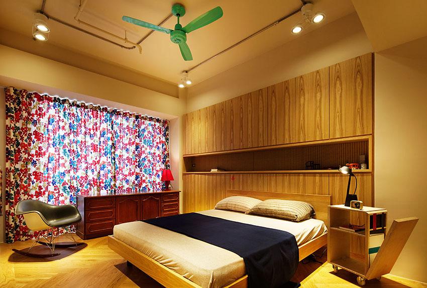 冷酷的工业风,在卧室中也要屈服于温馨与舒适,用一个绿色吊扇来点缀,跳跃式的活跃,让空间不单调。