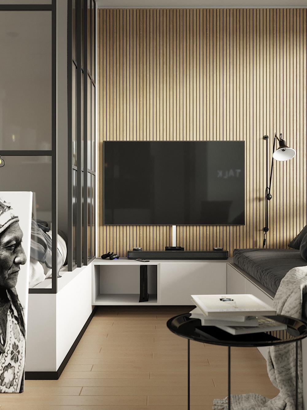 背景墙基础色调采用圆弧暮色, 挂式电视机点缀凸显强烈的艺术感。