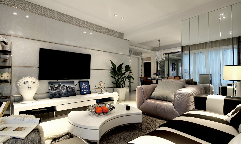 客厅背景墙很是时尚,电视柜旁边摆放着艺术感的大头像,很是有艺术气息