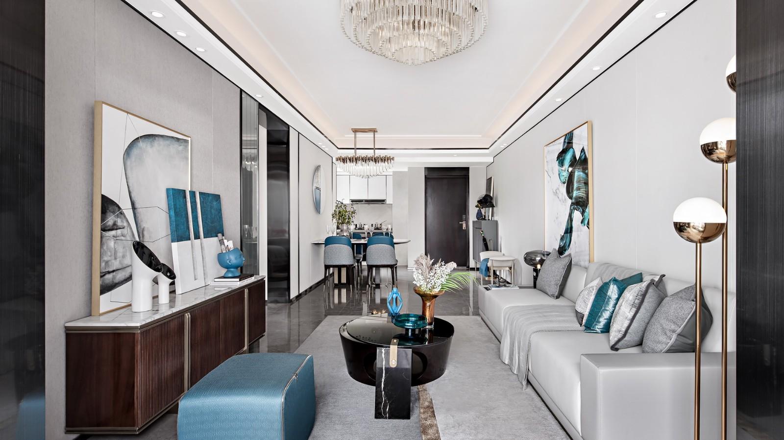 以高级灰为主,以优雅蓝为点缀色,呈现出满满的格调感;回型吊顶直接延伸到餐厅区域,加以黑色收边和谐统一