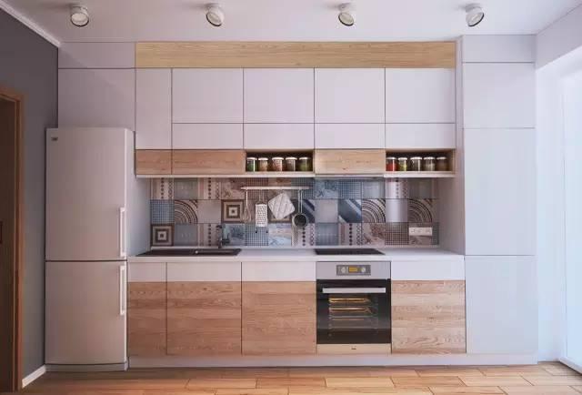 一道,隔开了空间同时也阻挡了厨房的油烟,依旧是木、白、几何花砖的组合 ,嵌入式的设计方式。