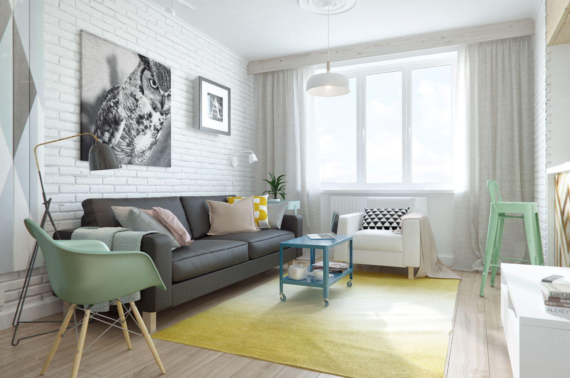 客厅整体清新亮丽,皮质黑色沙发,以及背景墙上挂着挂画,整个很有艺术气息