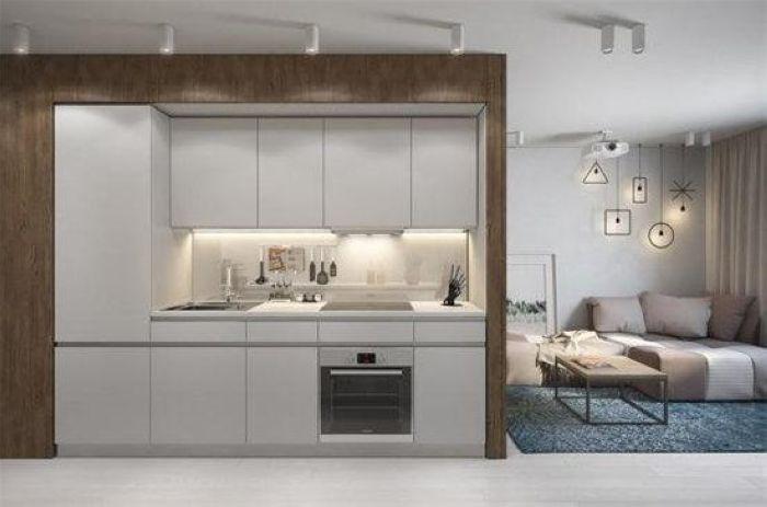 把迷你厨房内置在卧室的长方体内,虽然不大,但收纳空间、烤箱、冰箱等都齐全,一人足够。