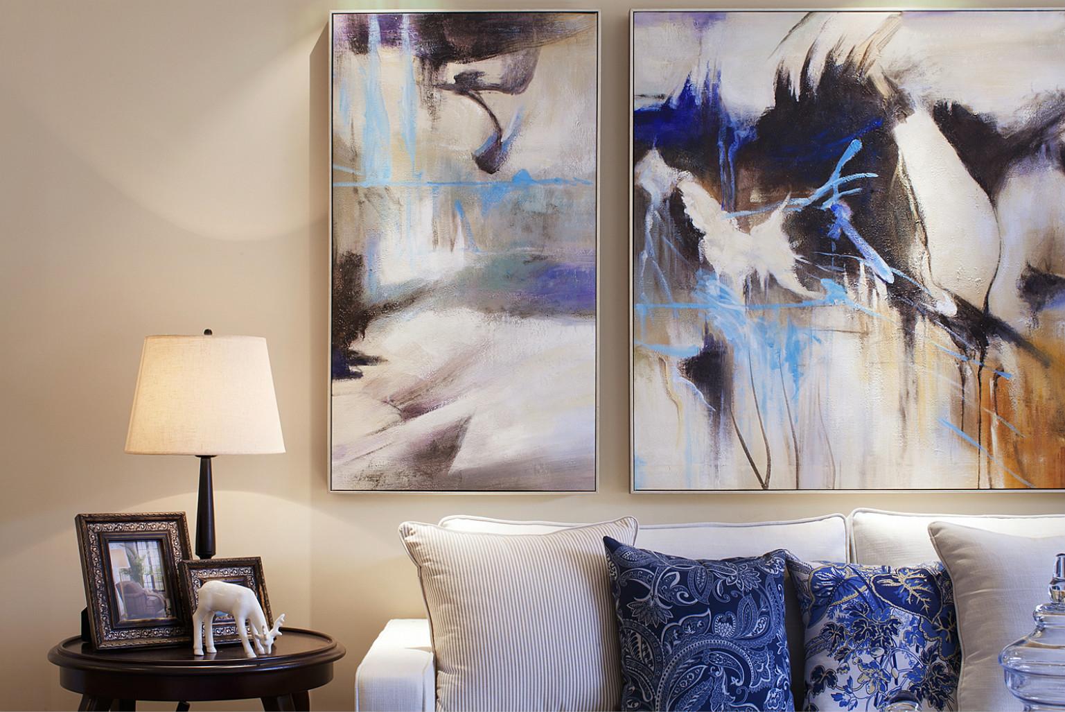 客厅背景墙的画,更是突出了整个客厅的简约大气