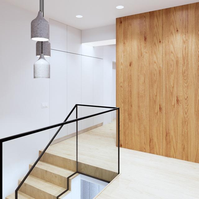 这样简单却并不粗暴的楼梯扶手设计,条纹清晰的原木柜和白墙被衬托出一种别样的时尚。