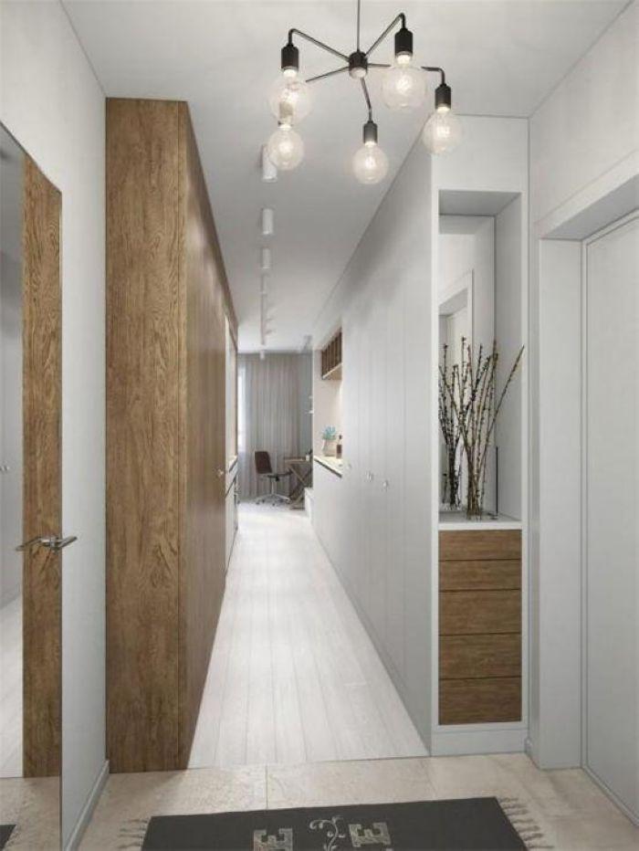 入门面对一条狭长的走道,木质搭配纯净白色,清新与自然并存,