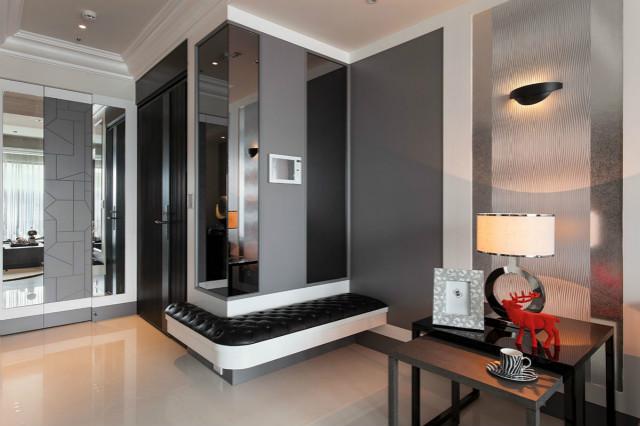 本案玄关设计并不没有很复杂,围墙设计黑色座椅,方便简捷。