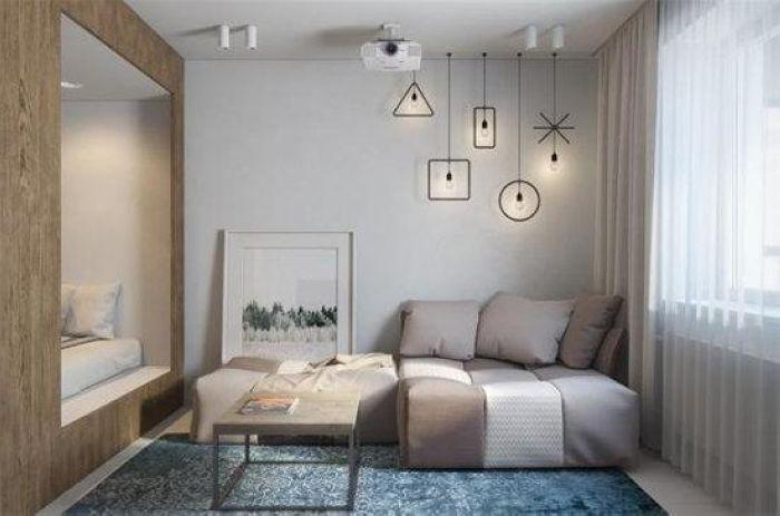 在墙面贴了形状线条搭配简单的灯具,从前往后看很有立体感,创意十足。
