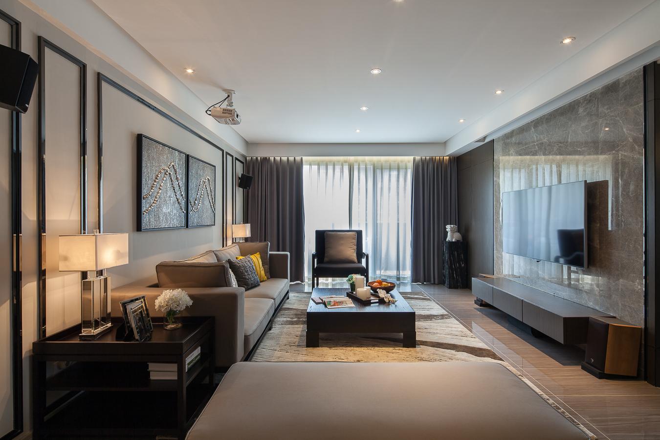 客厅整个没有独立的吊灯设置,让简约之美更加凸显。