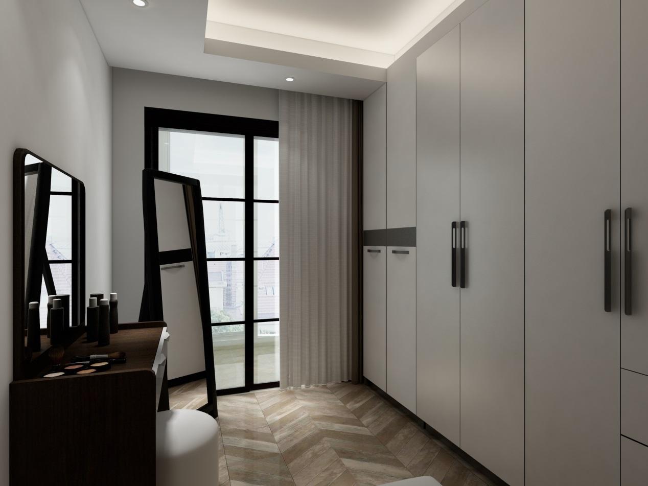 业主家的衣帽间也比较大,一扇落地窗增加了房间的亮度;一侧墙全部打造成衣柜,收纳功能十分强大