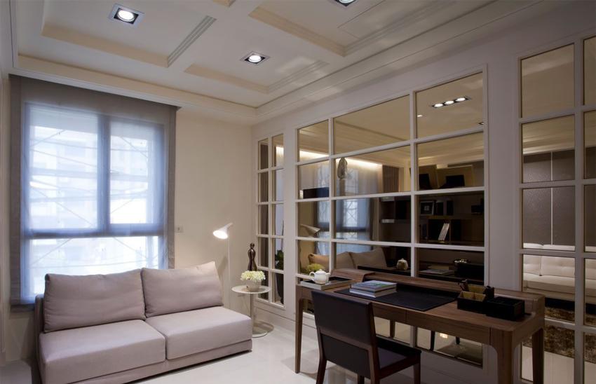 以茶玻镶嵌经典的格子窗造型为客厅、廊道隔间,新增出的空间量体保有开放穿透的视觉感受。