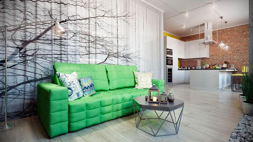 绿色的沙发给客厅点缀这个温暖的气息