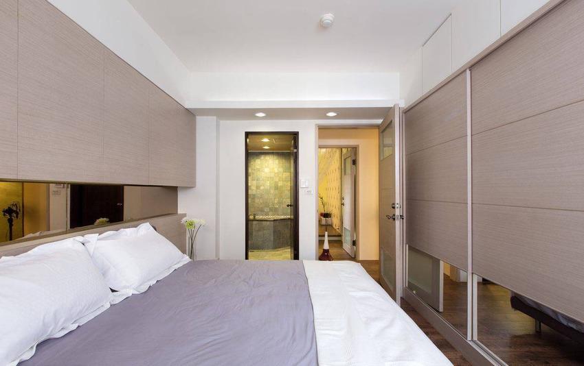 镜面的运用于床头、衣柜下端,在虚实之间延展可空间边界。