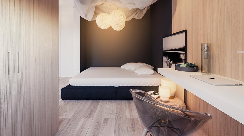 工作台被纳入卧室内,设计简洁。黑+白+木的三色搭配,温润静谧,能令浮躁的心平静下来。