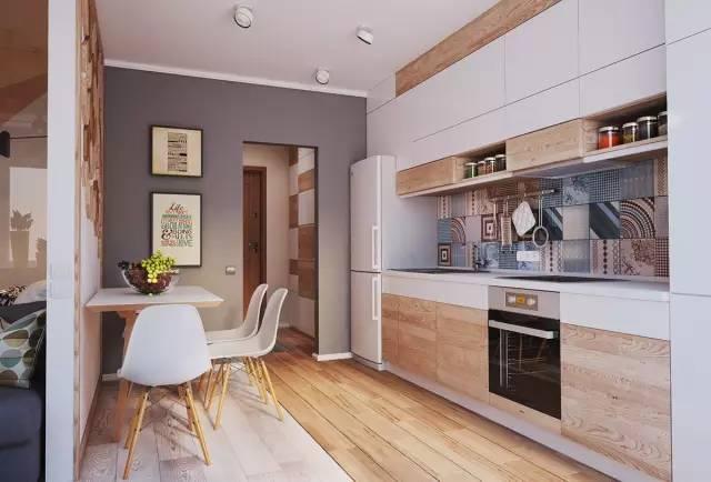 深灰色的隔断墙 一面是入口的玄 一面是餐厨合体的空间 ,所有的功能间 都是依靠着墙体,来节约面积。