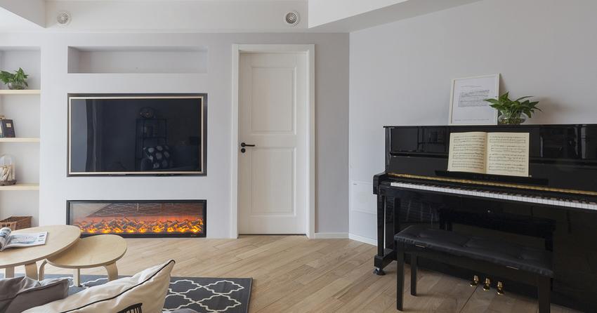 宽敞的客厅放置一架钢琴,巧妙将琴房融入客厅设计中。