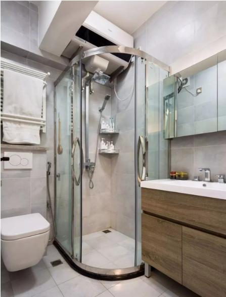卫生间地面与墙面通铺灰色瓷砖,墙排马桶安装喷枪,方便清理。