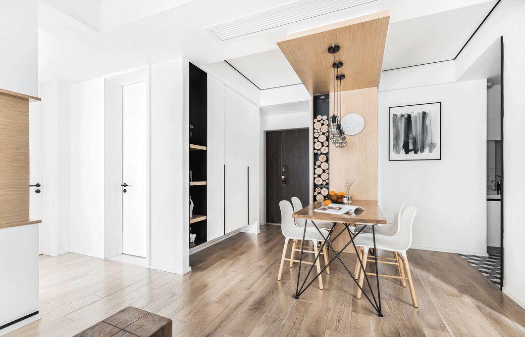 厨房存储空间较小,于是在餐厅空间增加了一个可三面开的高柜,并与餐桌融合做了整体设计,高柜实用又美观。