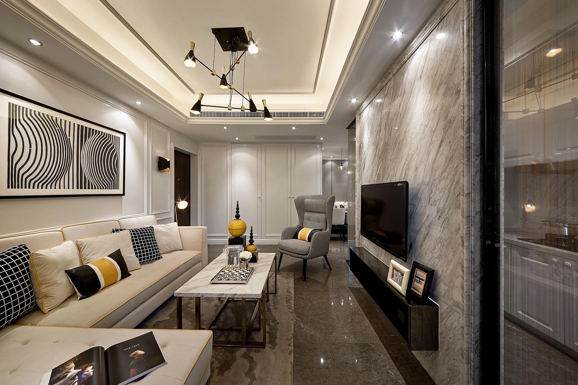 客厅线条流畅,给人感觉干净舒爽,浅色设计让空间很明亮,大理石电视背景墙质感十足。