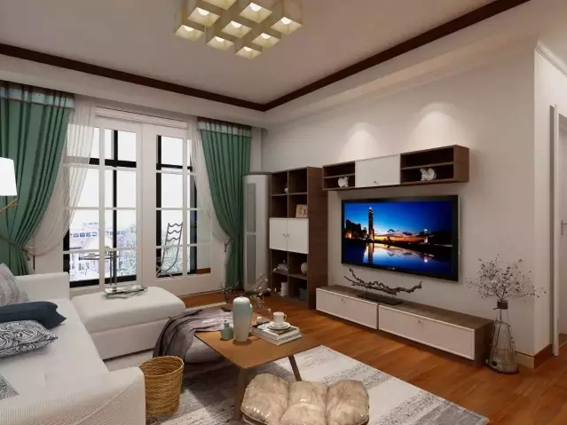 灰白色棉麻布艺沙发搭配北欧风的地毯,提升了整个空间的格调;墙上两幅小鹿画框是女主人的最爱